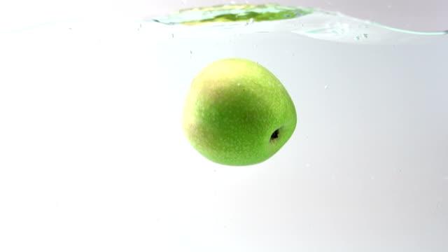 Apple splashing into water