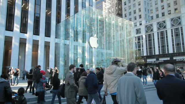 ws slo mo apple store and pedestrians on 5th avenue / new york city, new york, usa. - apple store stock videos & royalty-free footage