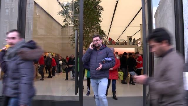 Apple Store GVs / antivirus company ENGLAND London Regent Street EXT GVs Apple Store / customers looking at iPhones