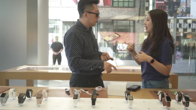 Apple Watches stand on display at the Apple Inc store at Sanlitun during the launch of the iPhone 8 in Beijing China on Friday Sept 22 An employee...