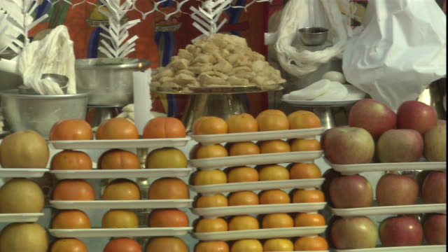 apples, oranges and other fruit are stacked on display trays. - cream cake stock videos & royalty-free footage