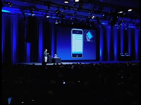 apple's technician demonstrates applications of the new iphones during the worldwide developers conference in san francisco. - 2000s style stock videos & royalty-free footage