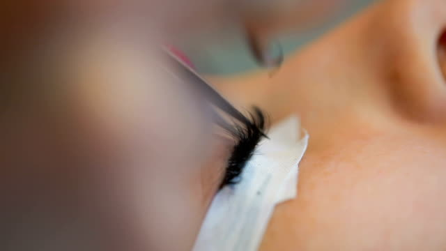 application of false eyelashes - beautician stock videos and b-roll footage
