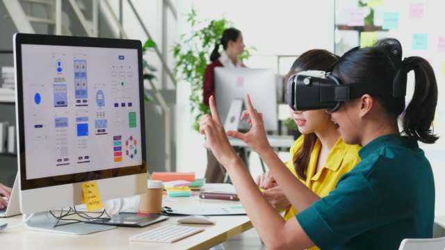 vr application test, asian man with virtual reality glasses headset touching air during the vr experience, young asia male developer meeting with virtual reality simulator application test at creative office, ux, ui startup, small business concept - smart stock videos & royalty-free footage