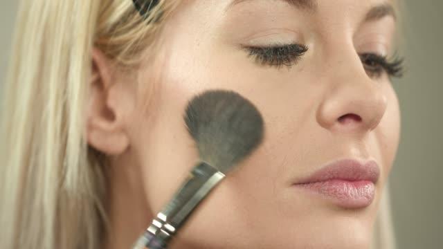 applying blusher with make-up brush - blusher stock videos & royalty-free footage