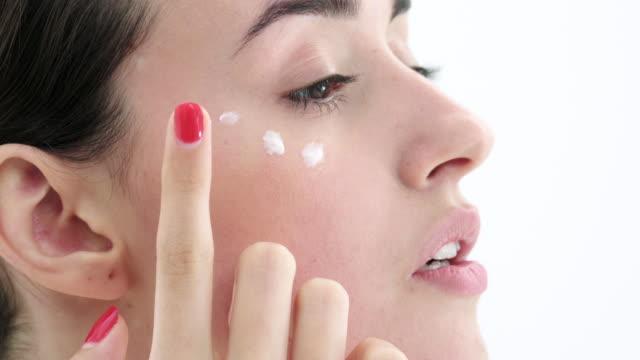 applying cream - face cream stock videos and b-roll footage