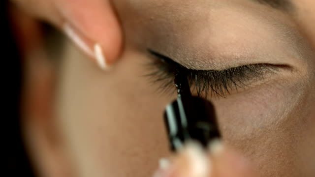 hd: applying eyeliner - make up stock videos and b-roll footage