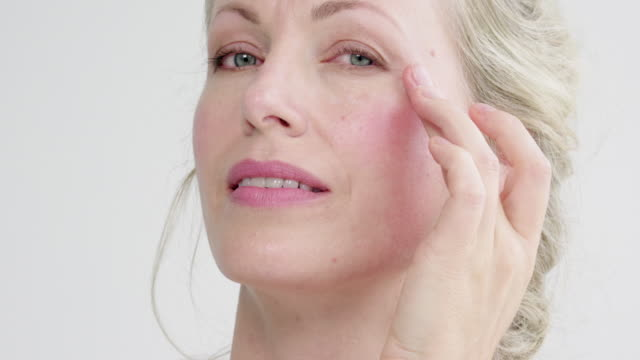 applying face cream - beautiful woman stock videos & royalty-free footage