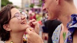 Applying glitter on the lips