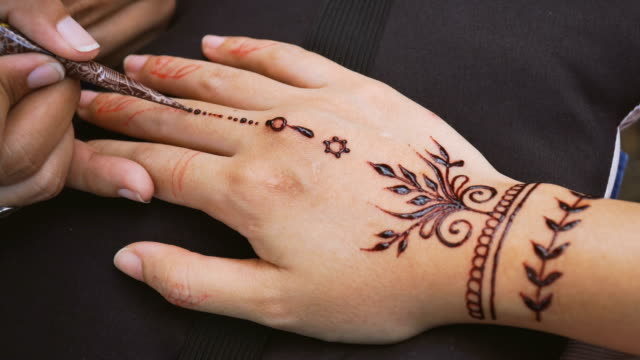 applying henna paint on fingers - mandala stock videos & royalty-free footage
