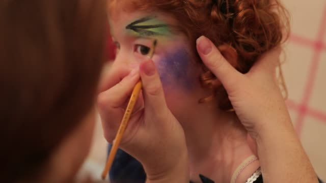 Applying Her Halloween Makeup