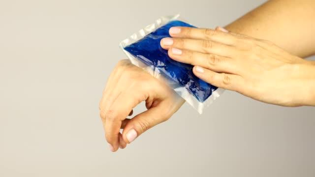 applying ice bag gently on injured wrist - wrist stock videos & royalty-free footage