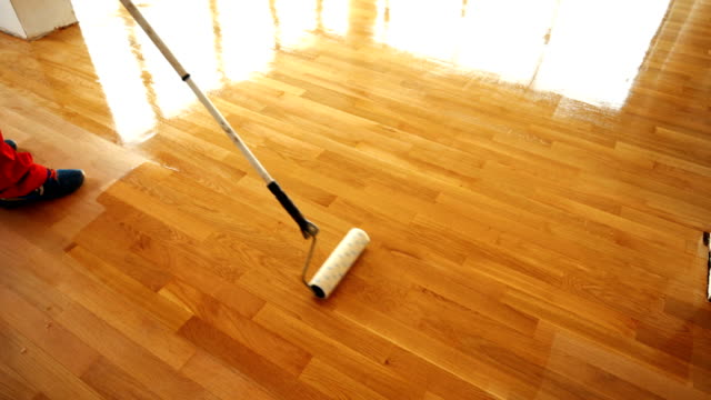 applying lacquer onto a hardwood floor. - flooring stock videos & royalty-free footage