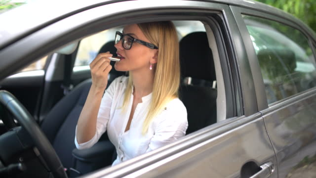 applying lipstick in the car - lipstick stock videos & royalty-free footage