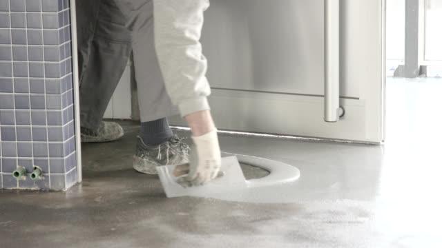 applying liquid resin coating on cement floor - flooring stock videos & royalty-free footage