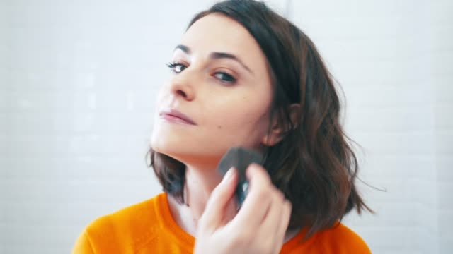 applying make up powder with a brush. - routine stock videos & royalty-free footage