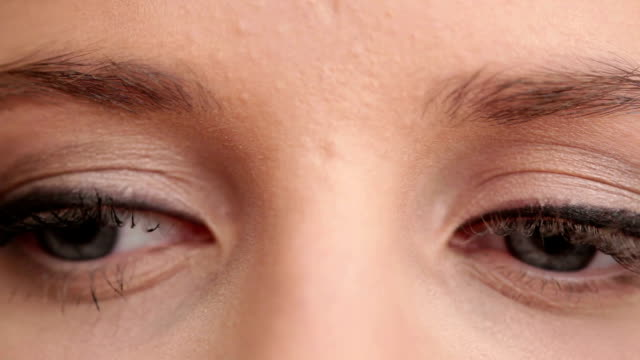 applying makeup on eyelashes macro - extreme close up stock videos & royalty-free footage
