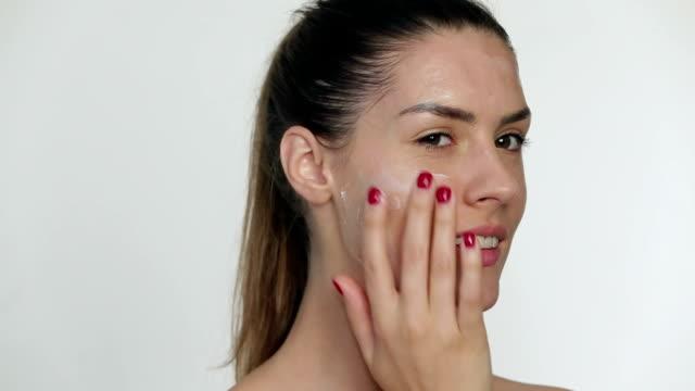 Applying moisturizing facial mask