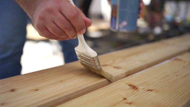 applying protective varnish on a wooden boards. - wood stain stock videos & royalty-free footage