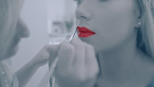 applying red lipstick - toned image stock videos & royalty-free footage