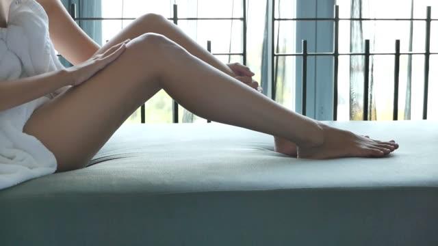 Applying suntan lotion moisturizer