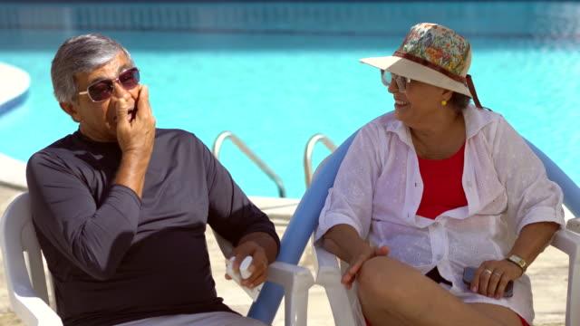applying suntan lotion - uv protection stock videos and b-roll footage