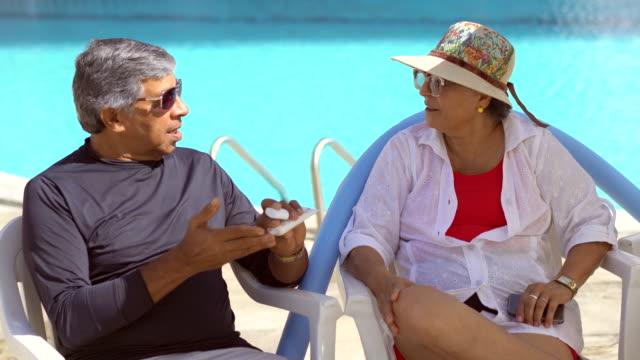 applying suntan lotion - 70 79 years stock videos & royalty-free footage