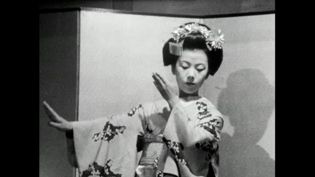 ms apprentice geisha dances elegantly on stage ;1966 - femininity stock videos & royalty-free footage