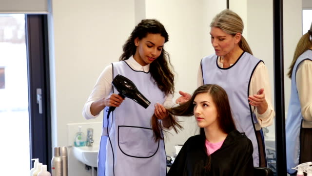 apprentice hairdresser - beauty salon stock videos and b-roll footage
