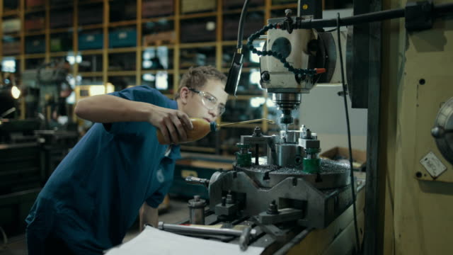 apprentice training in a german machine factory - metal worker stock videos & royalty-free footage