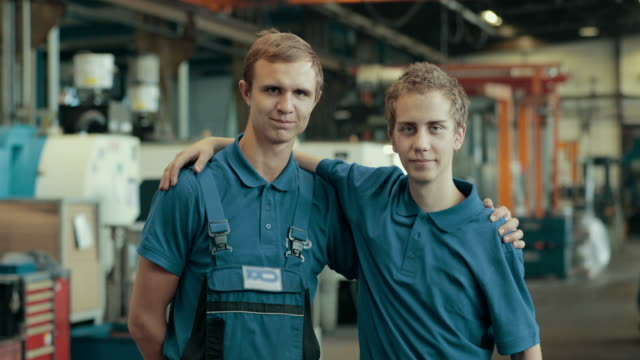 apprentice training in a german machine factory - arm around stock videos and b-roll footage