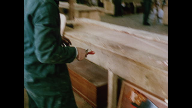 montage apprentices building wooden boats at training center in south coast / united kingdom - toolbox stock videos and b-roll footage