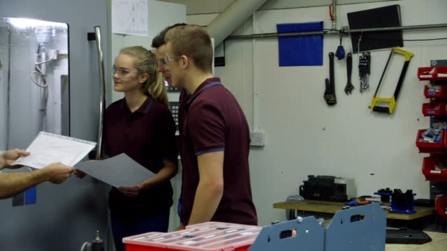 apprentices in the workplace - manufacturing occupation stock videos & royalty-free footage