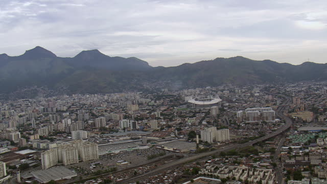 ws aerial approach to olympic stadium and traffic on street / rio de janeiro, brazil - rio de janeiro stock videos & royalty-free footage