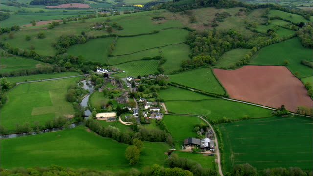 approach to skenfrith castle - aerial view - wales,  monmouthshire,  united kingdom - english culture stock videos & royalty-free footage