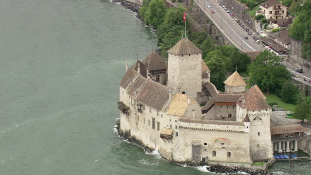 ws aerial approach tot chillon castle on the shore of lake geneva / vaud, switzerland - montreux stock videos and b-roll footage