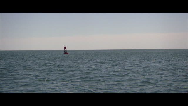 POV Approaching a buoy in a waterway, and the green water surrounding it
