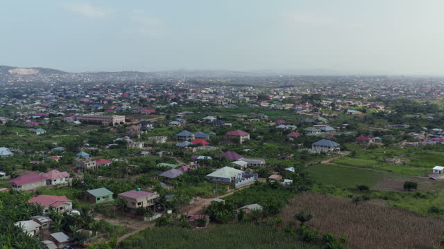 approaching a town in ghana from aerial view - ghana stock videos & royalty-free footage