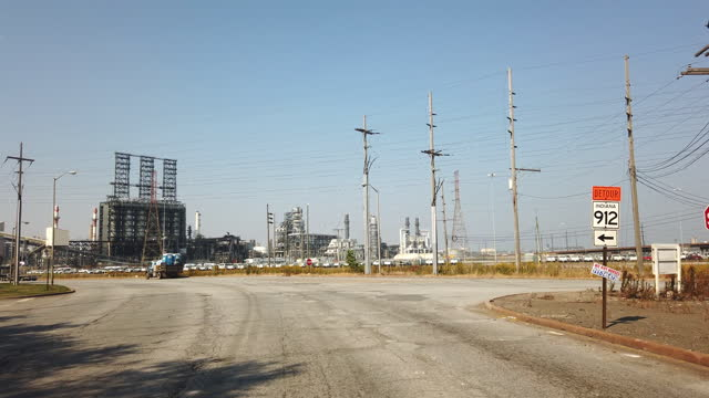 approaching an oil refinery plant in the south of chicago amid the 2020 global coronavirus pandemic. - fossil fuel stock videos & royalty-free footage