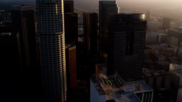 approaching and flying close past skyscrapers of los angeles financial district.  shot in october 2010. - office block exterior stock videos & royalty-free footage
