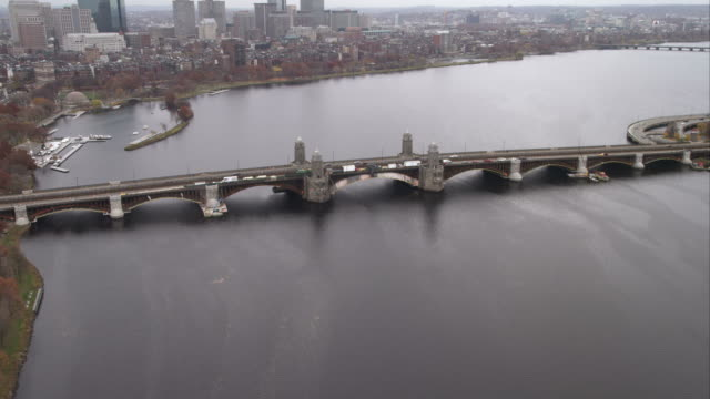 approaching and flying over harvard bridge on the charles river, boston. shot in november 2011. - artbeats stock videos & royalty-free footage