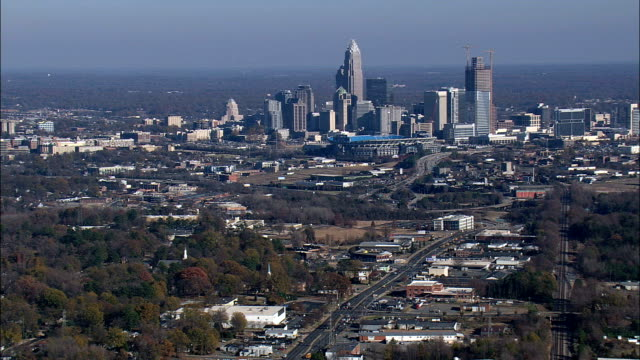 approaching charlotte  - aerial view - north carolina,  mecklenburg county,  united states - charlotte north carolina stock videos & royalty-free footage