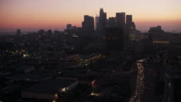 AERIAL Approaching Downtown LA at dusk