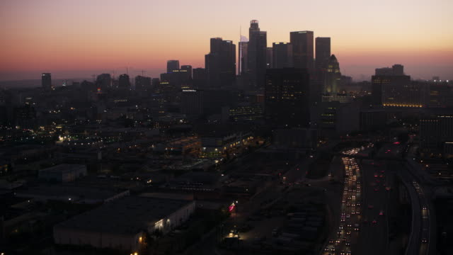 aerial approaching downtown la at dusk - zoom in stock videos & royalty-free footage