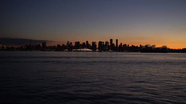 Approaching Downtown Vancouver over Water at Sunset