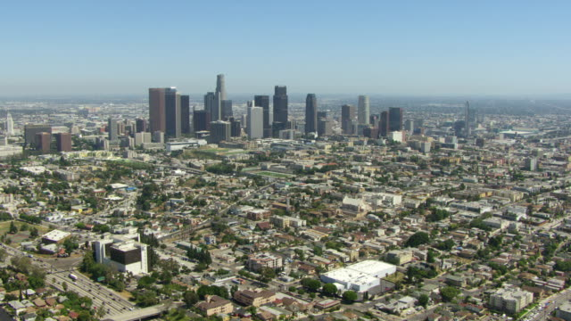 ws aerial pov approaching downtown la - city of los angeles stock videos & royalty-free footage