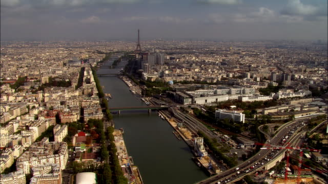 AERIAL approaching Eiffel Tower over Seine/ Paris, France