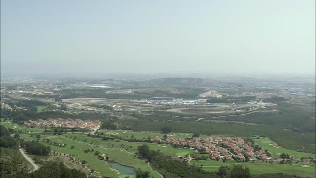 aerial ws approaching estoril formula 1 race course / pena, setubal, portugal - エストリル点の映像素材/bロール