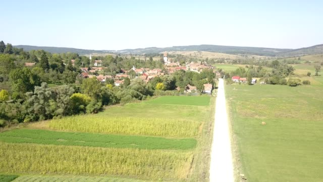 approaching flight towards the fortified church in toarcla - transilvania video stock e b–roll