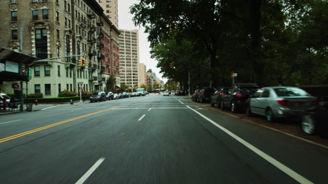vidéos et rushes de approaching frederick douglass circle on central park west - driving shot - destination de voyage